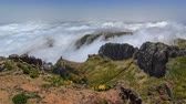 madeira : View down over the clouds from slopes of Pico do Arieiro, Madeira, Portugal timelapse 4K