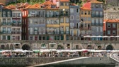 roof : Embankment and traditional quaint houses in the old, vintage and touristic ribeira district of Porto at sunny day timelapse, Portugal 4K