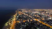 best : Cityscape of Ajman from rooftop from day to nigh transition timelapse. Ajman is the capital of the emirate of Ajman in the United Arab Emirates. fisheye 4K