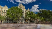 statue : The famous Ramblas street timelapse hyperlapse with unidentified walking tourists in Barcelona, Spain