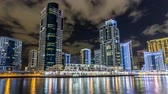 meal : View of Dubai Marina Towers and canal in Dubai night timelapse hyperlapse