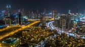 landmark : Scenic aerial view of a big modern city at night timelapse. Business bay, Dubai, United Arab Emirates.
