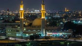 abstruse : Dubai skyline with Mosque illuminated at night timelapse. Dubai, United Arab Emirates