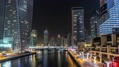 z��pad slunce : View of Dubai Marina Towers and canal in Dubai night timelapse hyperlapse