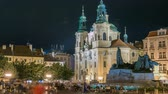 astrolojik : Baroque St. Nicholas Cathedral on the Oldtown Square in Prague with monument Jan Hus illuminated at night timelapse