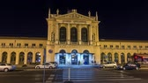 main entrance : People on the Tomislav Square in front of Main Railway Station night timelapse hyperlapse, main hub of Croatian Railways network. ZAGREB, CROATIA Stock Footage