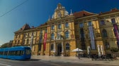 tram : A view of the Museum of Arts and Crafts timelapse hyperlapse in Zagreb during the day. ZAGREB, CROATIA Stock Footage