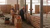 harç : Bricklayers laying bricks to make a walls timelapse.