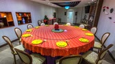 guloseima : Red tableware and yellow plates and cups on round table timelapse stop-motion animation. Tableware sets for dinner chinese style.