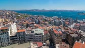 bizantino : The view from Galata Tower to Golden Horn and Bosphorus, city skyline with red roofs timelapse, Istanbul, Turkey Vídeos