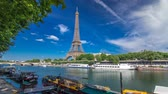 seine : The Eiffel tower timelapse hyperlapse from embankment at the river Seine in Paris