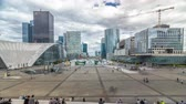 la defense : Skyscrapers of La Defense timelapse hyperlapse modern business and financial district in Paris with highrise buildings and convention center Stock Footage