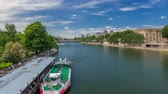 efsanevi : Touristic boat passes below Pont des Arts and stop on boat station on Seine river timelapse hyperlapse in Paris.