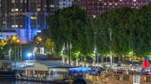 Seine river with ship in Paris at night timelapse, waterfront of the seine river in the city of Paris in france