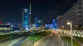 milano : Milan skyline with modern skyscrapers in Porta Nuova business district night timelapse hyperlapse in Milan, Italy Stock Footage