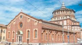 lombardia : Santa Maria delle Grazie timelapse with blue cloudy sky.