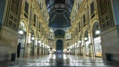 milano : Entrance to the Galleria Vittorio Emanuele II timelapse from Via Tommaso Grossi at night.