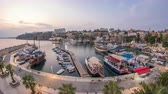 antalya : Aerial view of yacht harbor and red house roofs in Old town day to night timelapse Antalya, Turkey.