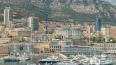 palácio : Monte Carlo city aerial panorama timelapse. View of luxury yachts and buildings in harbor of Monaco, Cote dAzur.