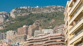 bilinen : Monaco, Monte Carlo architecture on mountain hill background timelapse. Many multi-story houses, buildings. Stok Video