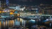 fontvieille : Panorama of Monte Carlo timelapse at night from the observation deck in the village of Monaco with Port Hercules Stock Footage