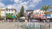тент : The Cumhuriyet square with numerous cafes and bars, statue of Attalos II and souvenir stores timelapse hyperlapse in Antalya.
