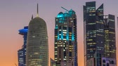 katar : The high-rise district of Doha day to night timelapse after sunset Stock Footage