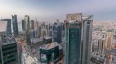 háztetők : The skyline of the West Bay area from top in Doha night to day timelapse, Qatar. Stock mozgókép