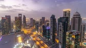 helipad : The skyline of the West Bay area from top in Doha day to night timelapse, Qatar.