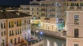 Венеция : Canal aerial top view in Venice-like Qanat Quartier of the Pearl precinct of Doha night timelapse, Qatar. Стоковые видеозаписи