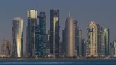qatar : Skyline of Doha night to day transition timelapse in Qatar