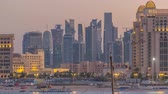 katar : View from Katara Beach day to night timelapse in Doha, Qatar, towards the West Bay and city center