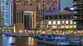 emirados Árabes unidos : View of Dubai Marina Towers and canal in Dubai day to night timelapse