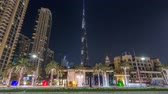 dubaj : View on modern skyscrapers and busy evening road timelapse hyperlapse in luxury Dubai city, Dubai downtown, United Arab Emirates