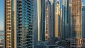 nejvyšší : View of modern skyscrapers shining in sunset lights timelapse in Dubai Marina in Dubai, UAE. Dostupné videozáznamy