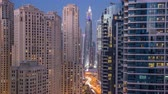 adres : Evening illumination of Dubai Marina day to night aerial timelapse, UAE.