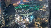 dubaj : Dubai Downtown night timelapse modern towers view from the top in Dubai, United Arab Emirates.