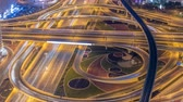 freeway interchange : Night traffic on a busy intersection on Sheikh Zayed highway aerial timelapse