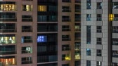 balcony view : Scenic glowing windows of skyscrapers at evening timelapse