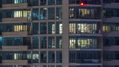 balcony view : Glowing windows of skyscrapers at evening timelapse Stock Footage