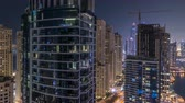 tetőtéri : Night illumination of Dubai Marina aerial timelapse, UAE.