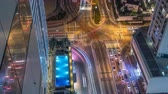 složitost : Aerial view of a road intersection in a big city night timelapse. Dostupné videozáznamy