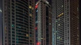 erkély : Scenic glowing windows of skyscrapers at night timelapse Stock mozgókép
