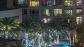 cena urbana : Rooftop swimming pool in Dubai marina night timelapse