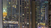 mesire : Water canal on Dubai Marina skyline at night timelapse.