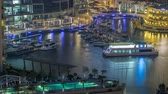 kuleleri : Promenade and canal in Dubai Marina with luxury skyscrapers and yachts around night timelapse, United Arab Emirates Stok Video