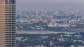 sharjah : Skyline view of Deira and Sharjah districts in Dubai timelapse at sunset, UAE.