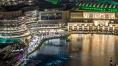 dubaj : Night aerial view Dancing fountains downtown and in a man-made lake timelapse in Dubai, UAE. Dostupné videozáznamy