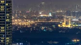 sharjah : Skyline view of Deira and Sharjah districts in Dubai timelapse at night, UAE.