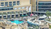 Средний Восток : Balcony of shopping mall and pool of fountains timelapse in Dubai, United Arab Emirates